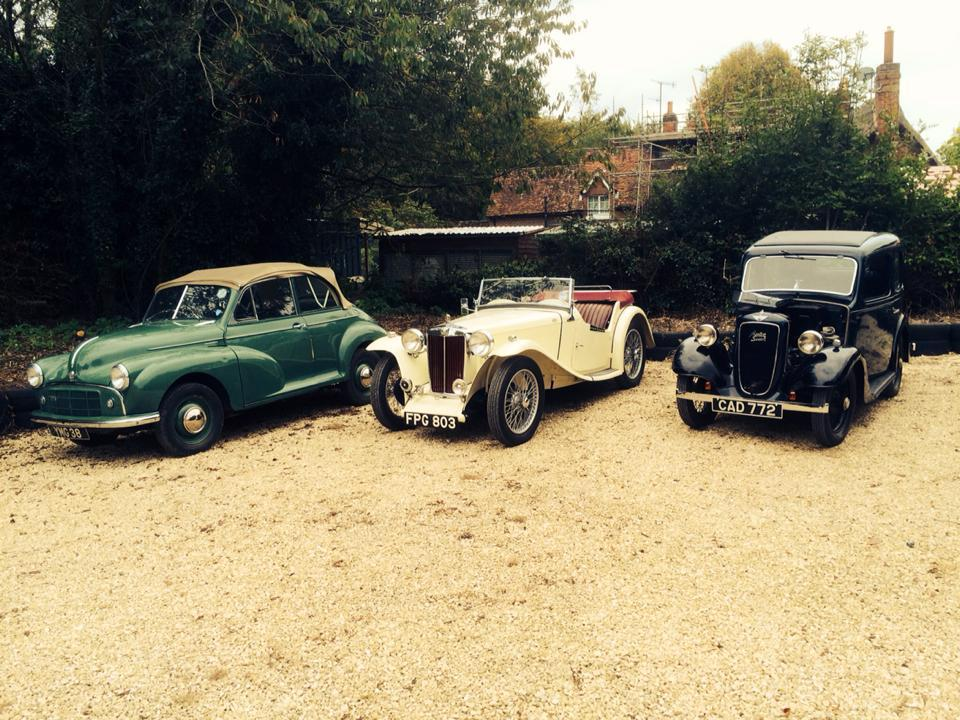A group of classic cars