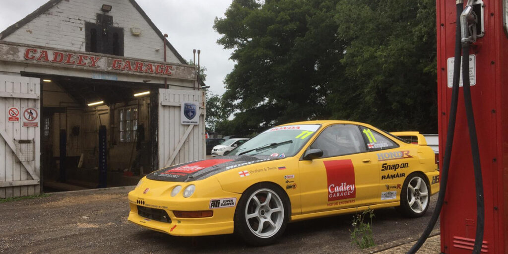 cadley garage and modern racing car